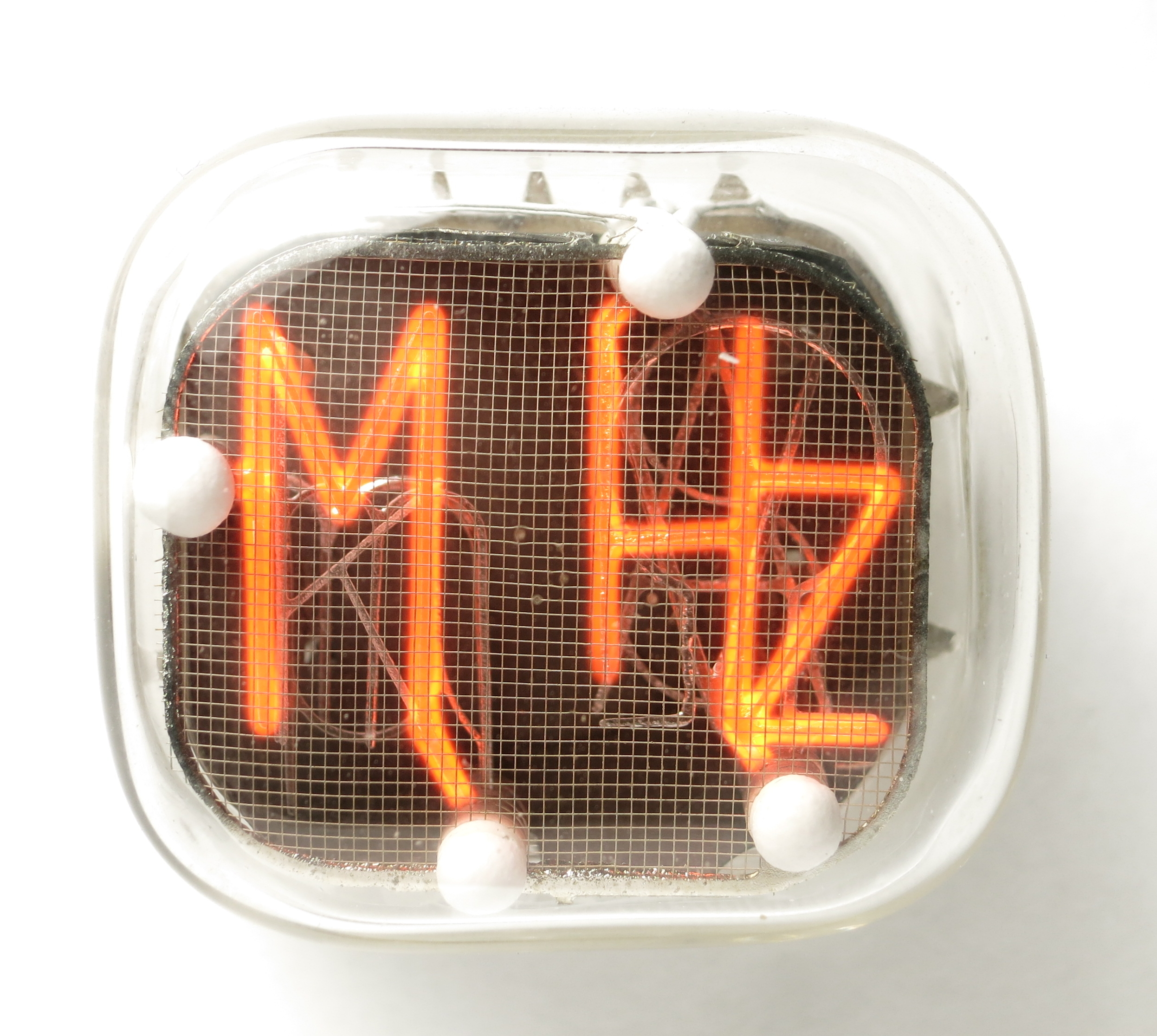 The combined symbol 'MHz' of the IN-XX